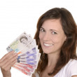 Young happy woman with british banknotes — Stock Photo