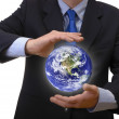 Stock Photo: Business man holding planet