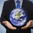Business man holding planet — Stock Photo