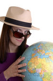 Attractive young woman with earth globe — Stockfoto