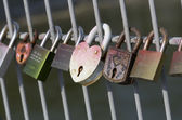 Love locks hanging on bridge — Stock Photo