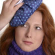Pretty red-haired womcooling her aching head — Stock Photo #32390021