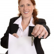Pretty red-haired business woman with contract and keys — Stock Photo