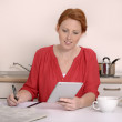 Pretty red-haired woman searching for job — Stock Photo