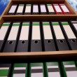 Stock Photo: Office cupboard with folders before cloudy sky