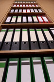 Office cupboard with folders, frog's perspective — Stock Photo