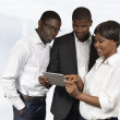 African Business People discussing with Tablet PC — Stock Photo