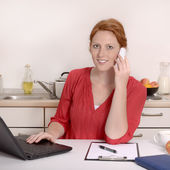 Pretty red haired Woman calling in Home Office — 图库照片