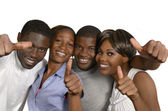 Four african friends showing thumbs up — Stock Photo