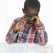 AfricBoy having stress while learning — Foto Stock #37014619