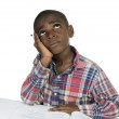 图库照片: AfricBoy having stress while learning