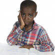 Photo: AfricBoy having stress while learning