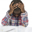 Foto Stock: AfricBoy having stress while learning
