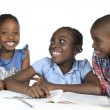 Three african kids learning together — Stock Photo