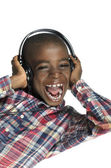 African boy with headphones listening to music — Stock Photo