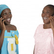African mother and daughter talking on cellphone — Stock Photo