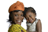 African woman carrying child — Stock Photo