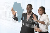 African business team working on virtual touchscreen — Stock Photo