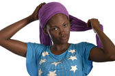 Young african woman putting her bandana on — Foto de Stock