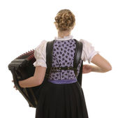 Rear view of young drindl woman playing accordion — Stock Photo