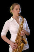Pretty young woman playing saxophone — Stock Photo