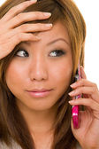Asian Beauty Remembers on Cellphone — Stock Photo