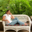 Stock Photo: Young WomRelaxing On Porch