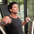 Stock Photo: Man Exercising Arm Muscles 6