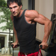 Stock Photo: Man Exercising Arm Muscles 1
