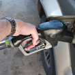 Hand Pumping Gas Fuel Into Auto — Stock Photo