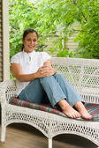 Young Woman Relaxing On The Porch 6 — Stock Photo