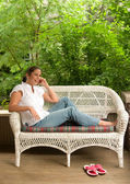Young Woman Relaxing On The Porch — Stock Photo
