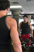 Man Exercising In Mirror — Stock Photo