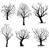 Vector set of silhouettes of trees — Stock Vector