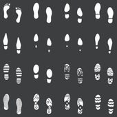 Vector set of 16 white footprint shoes — Stock Vector