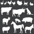 Vector white silhouettes of farm animals — Stock Vector