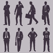 Vector set of silhouettes of business people — Stock Vector