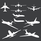 Vector set of white plane silhouettes — Stock Vector