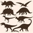 Stock Vector: Vector set of 8 dinosaurs silhouettes