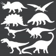 Vector set of white dinosaurs silhouettes — Stock Vector