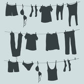 Silhouettes of Laundry on a Rope — Stock Vector