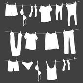 White Silhouettes of Laundry on a Rope — Stock Vector
