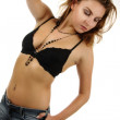 Sexy young girl posing in jeans and a black bra — Stock Photo