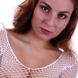 Portrait of a sexy young girl posing and a net shirt — Stock Photo #28518005
