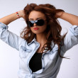 Portrait of a sexy young woman wearing sun glasses — Stock Photo