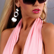 Stock Photo: Portrait of sexy busty girl posing with sunglasses