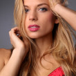 Portrait of a beautiful young woman wearing a red bra — Stock Photo #44886875