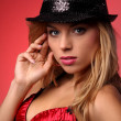 Portrait of a beautiful young woman wearing a red bra and a black hat — Stock Photo #44887007