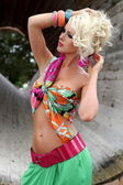 Sexy busty blonde young woman posing outdoor in colorful outfit — Stock Photo
