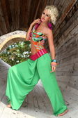 Sexy busty blonde young woman posing outdoor in colorful outfit — Foto de Stock